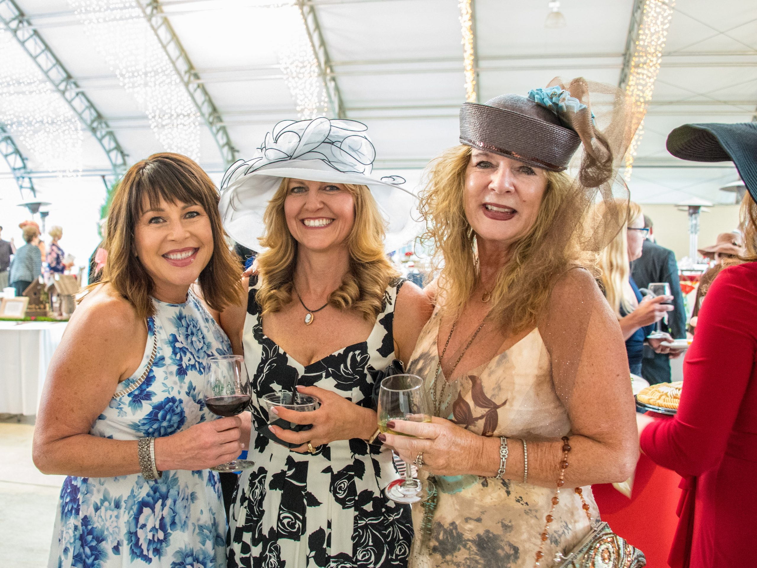 Photo of 3 ladies holding wine glasses at