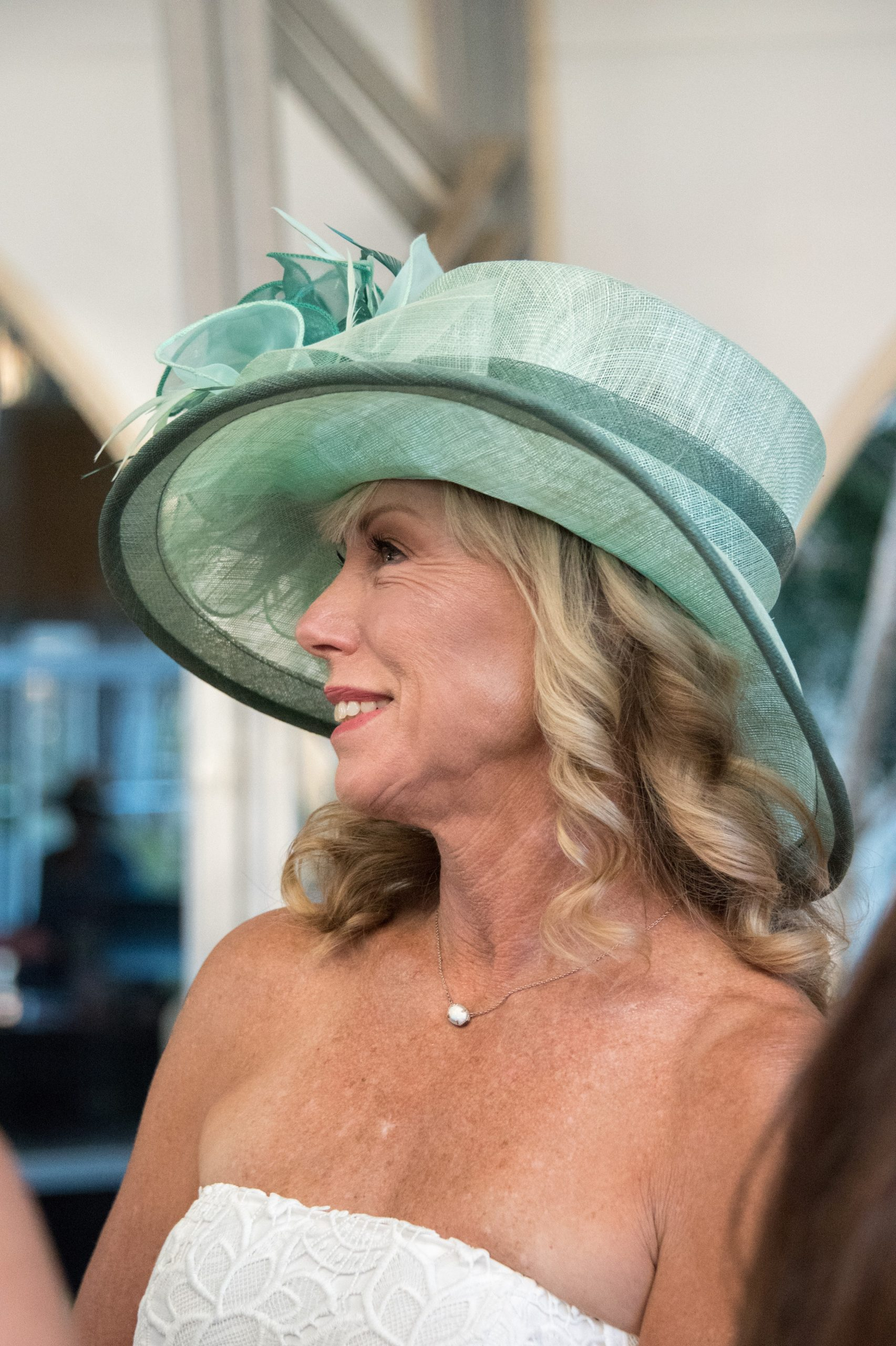 Photo of a woman in a green derby hat at
