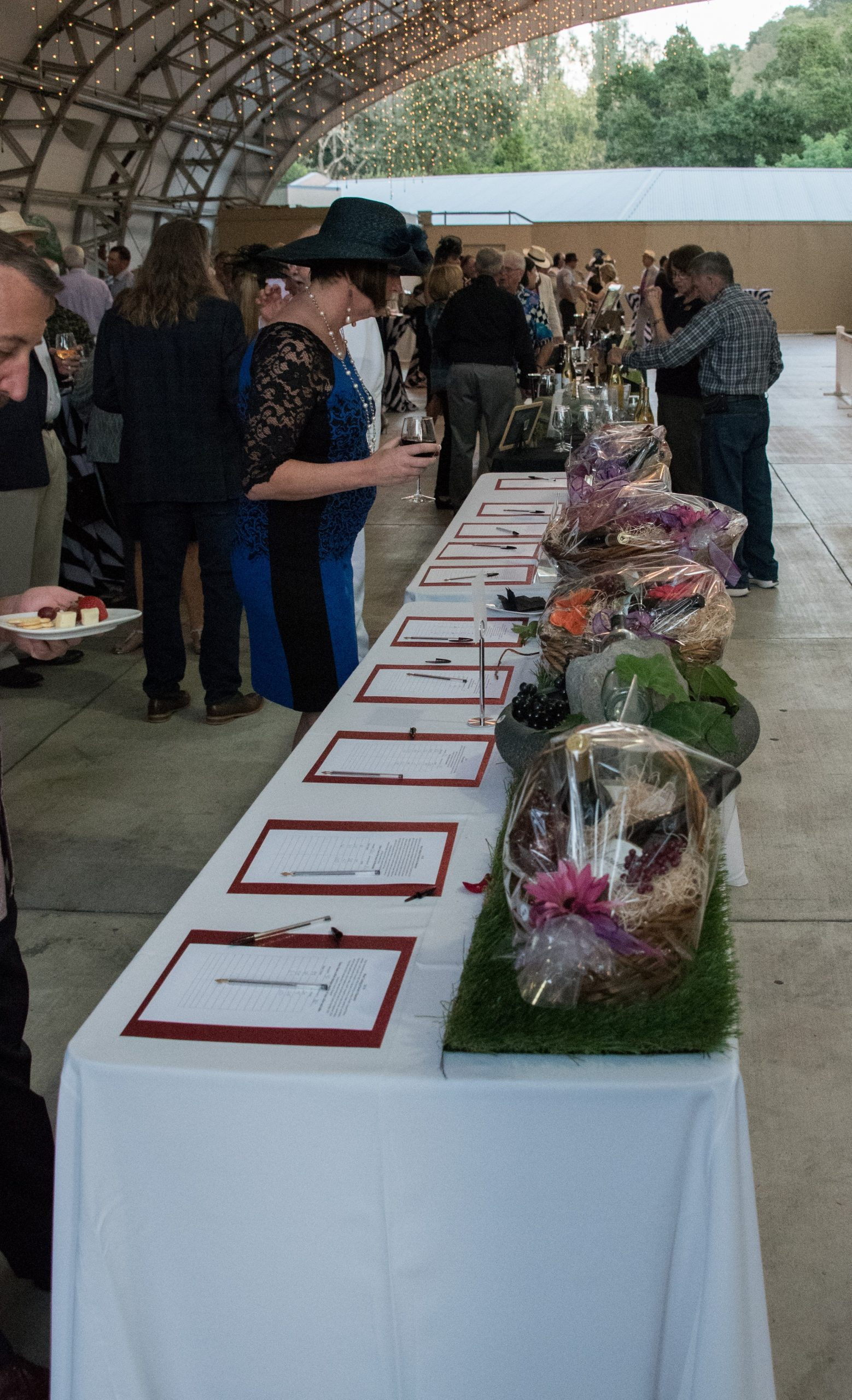 Photo of woman perusing the silent auction table at