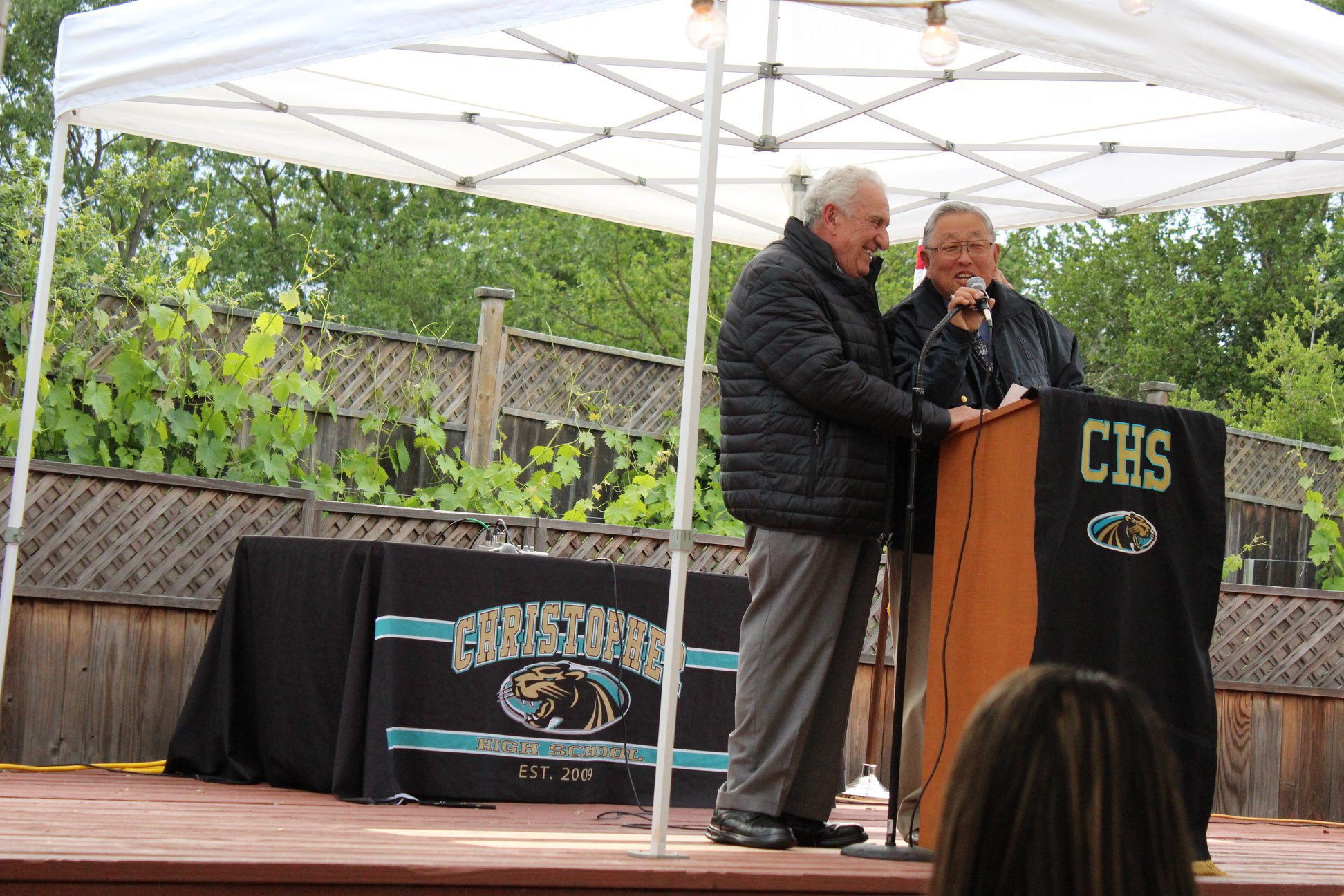 Photo of Gene Sakahara and Sam Bozzo at the podium
