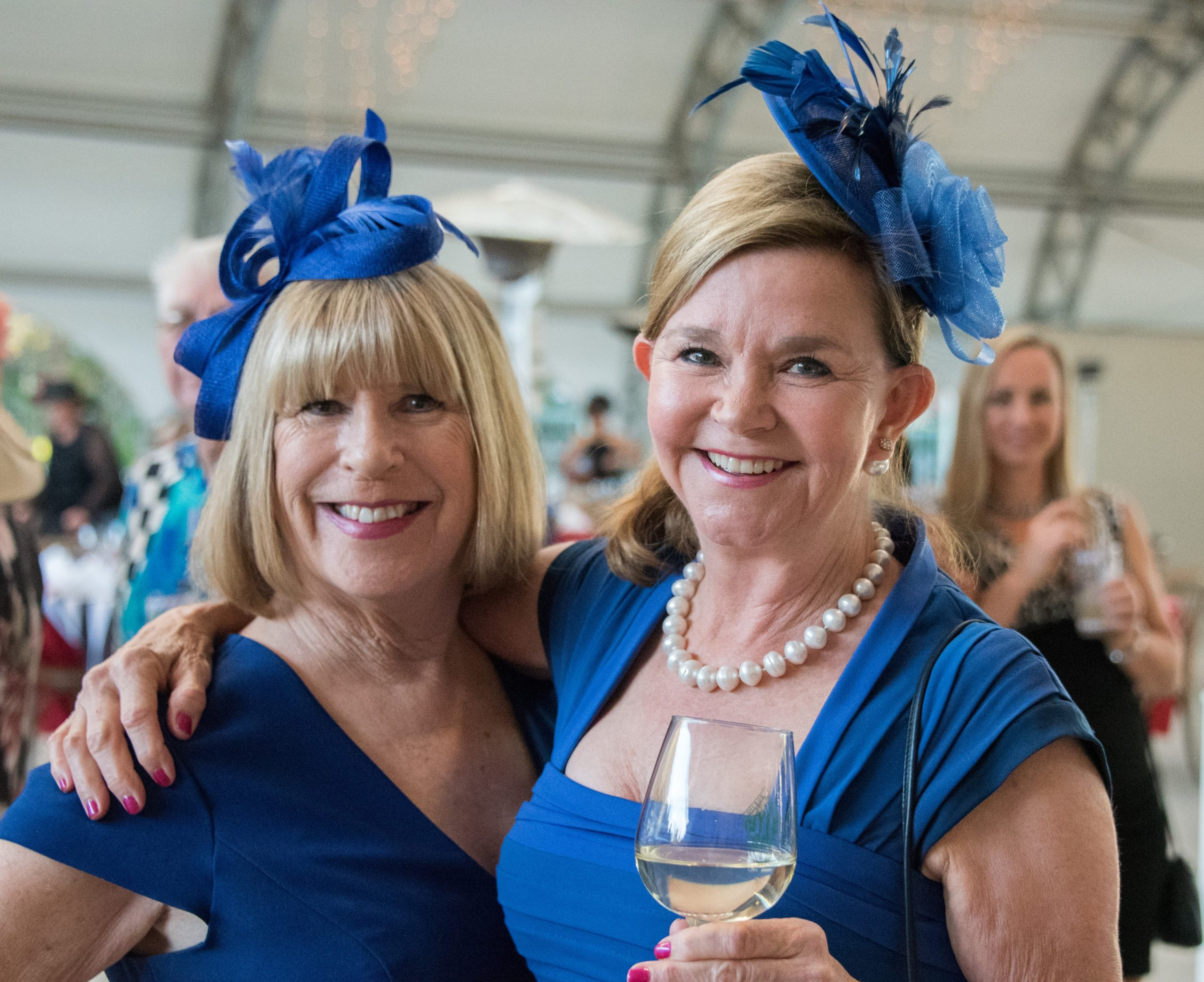 Photo of Donna Pray and Pam Martin in matching fascinators at