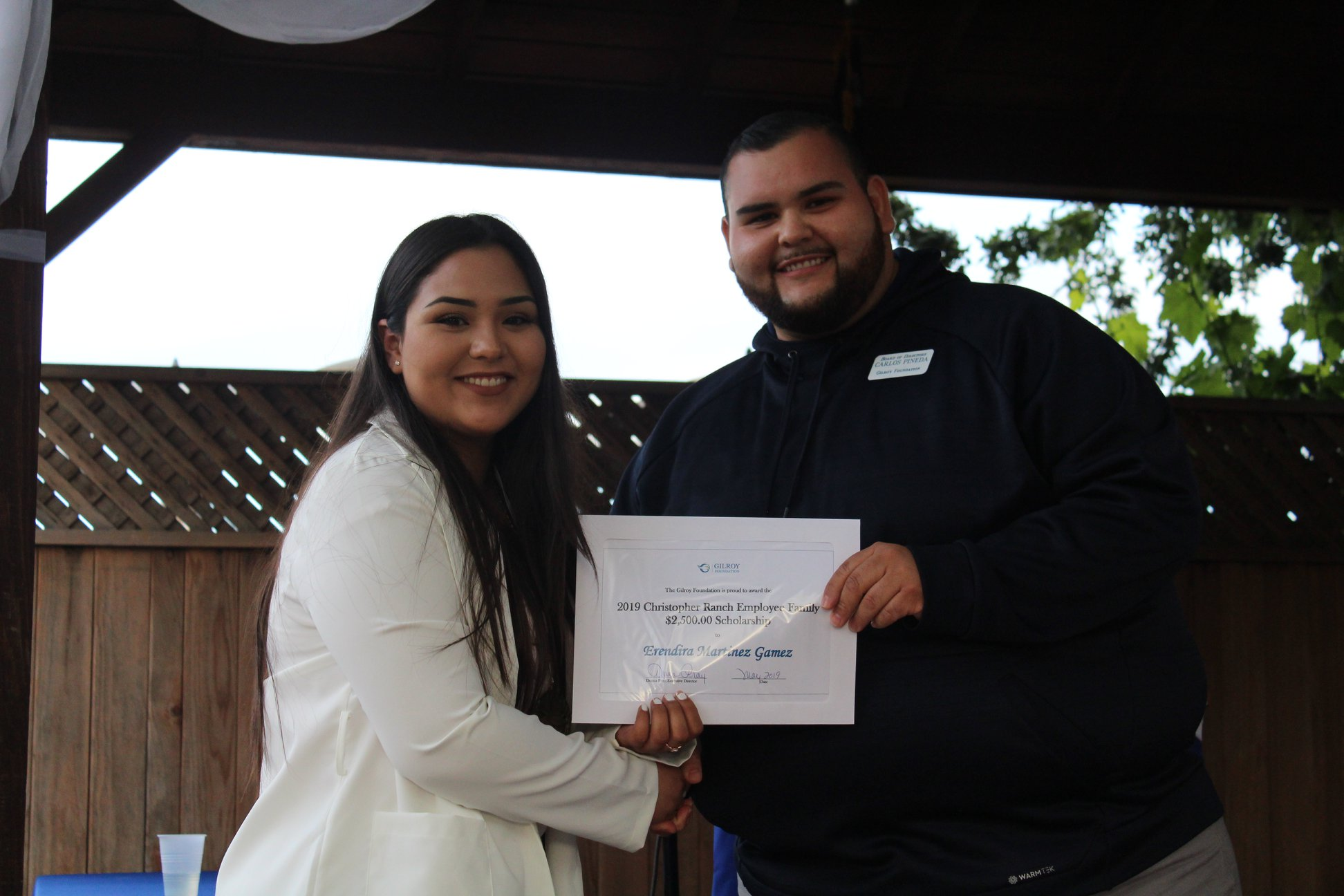 Photo of Carlos Pineda and a girl scholarship recipient
