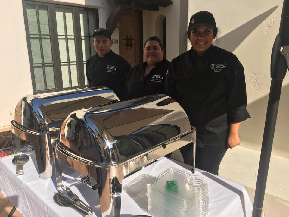 Photo of Kneaded Bakery Employees with chafing dishes at Gilroy Foundation Chamber Mixer
