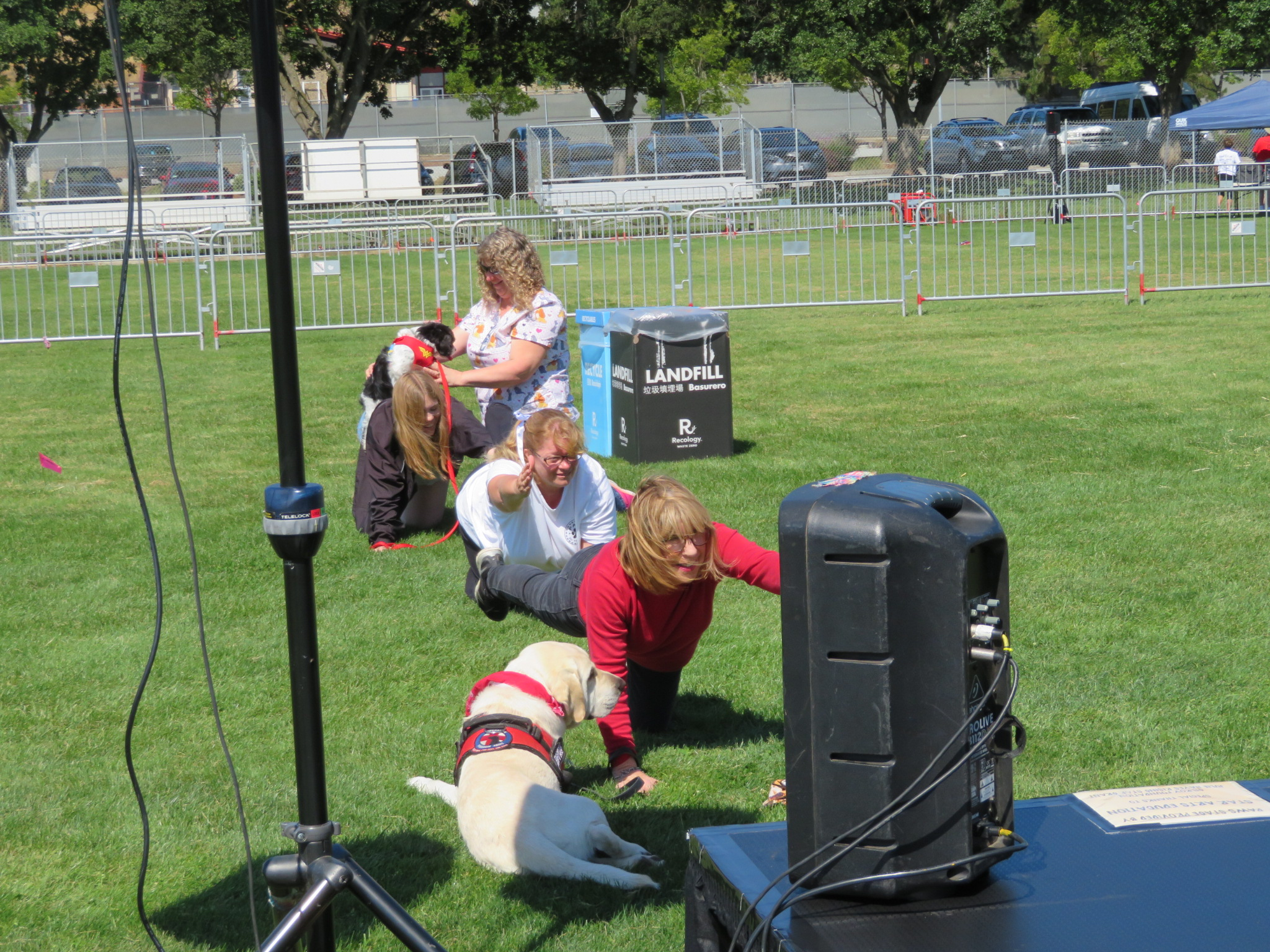 Photo of Donna Pray and her dog Rocco doing yoga at Paws in the Park 2019