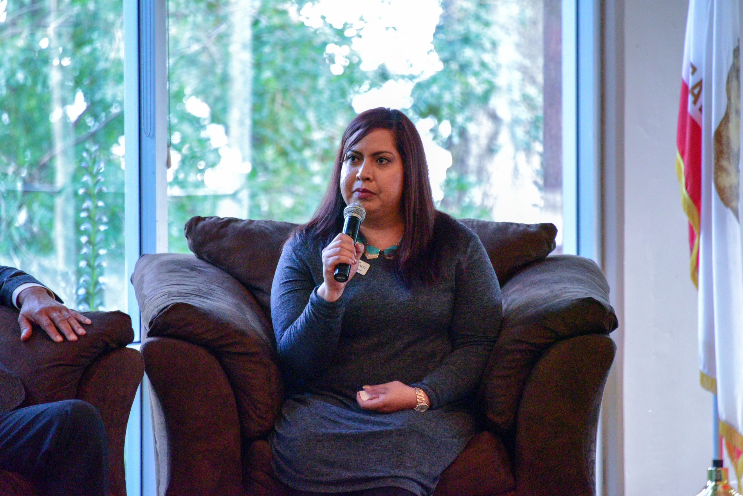 Photo of Yesenia Gonzalez speaking into a microphone