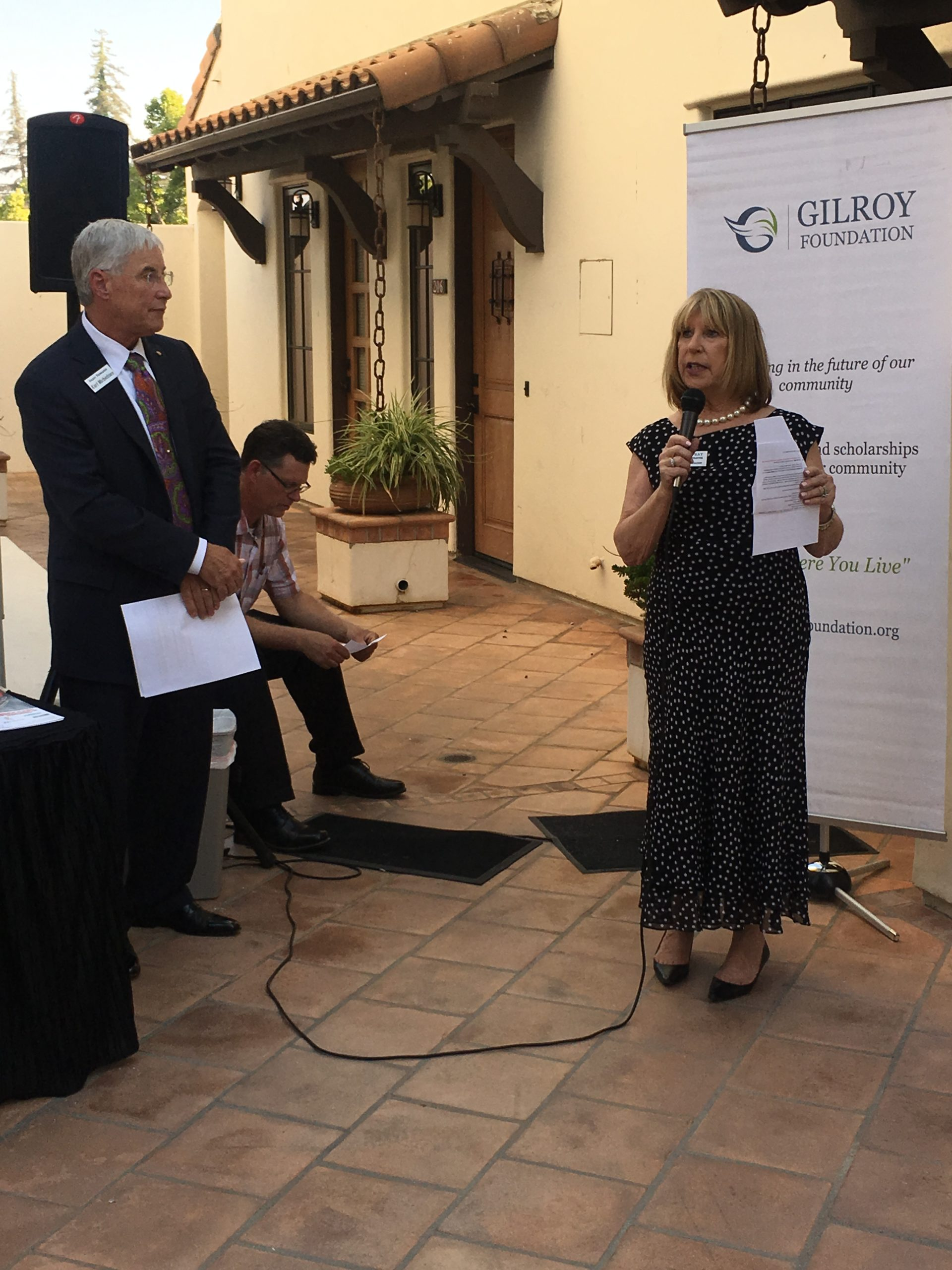 Photo of Executive Director, Donna Pray, Speaking on the Mic at Gilroy Foundation Chamber Mixer