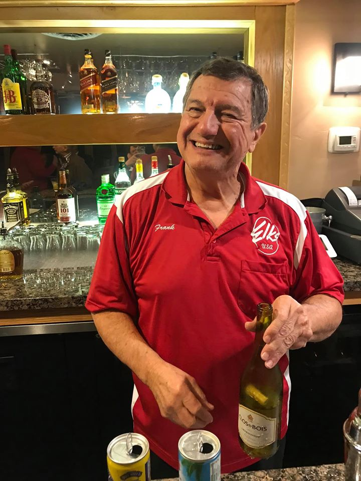 Photo of Frank Angelino tending bar