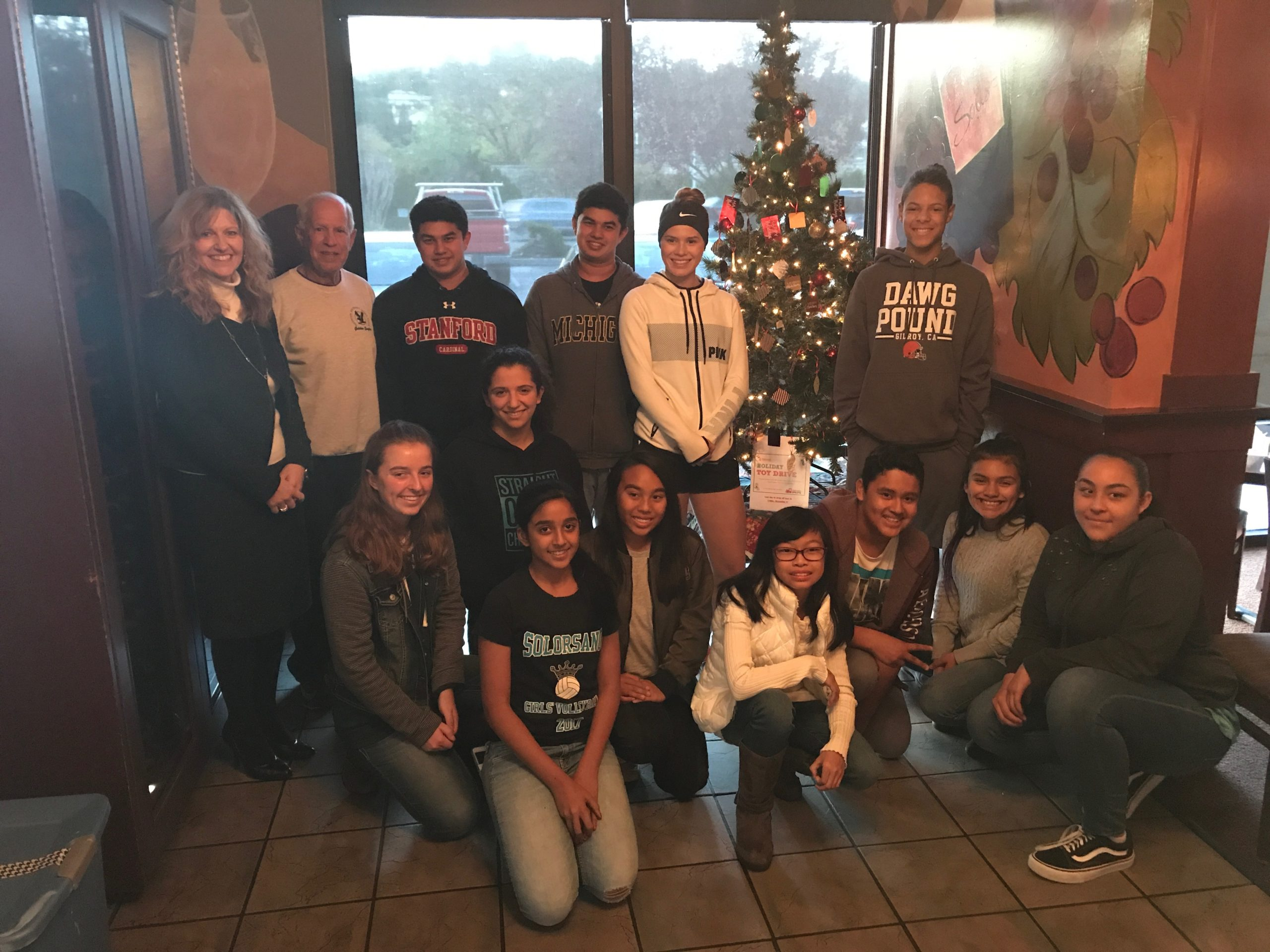 Photo of Youth Board kids with their decorated Giving Tree at West Side Grill