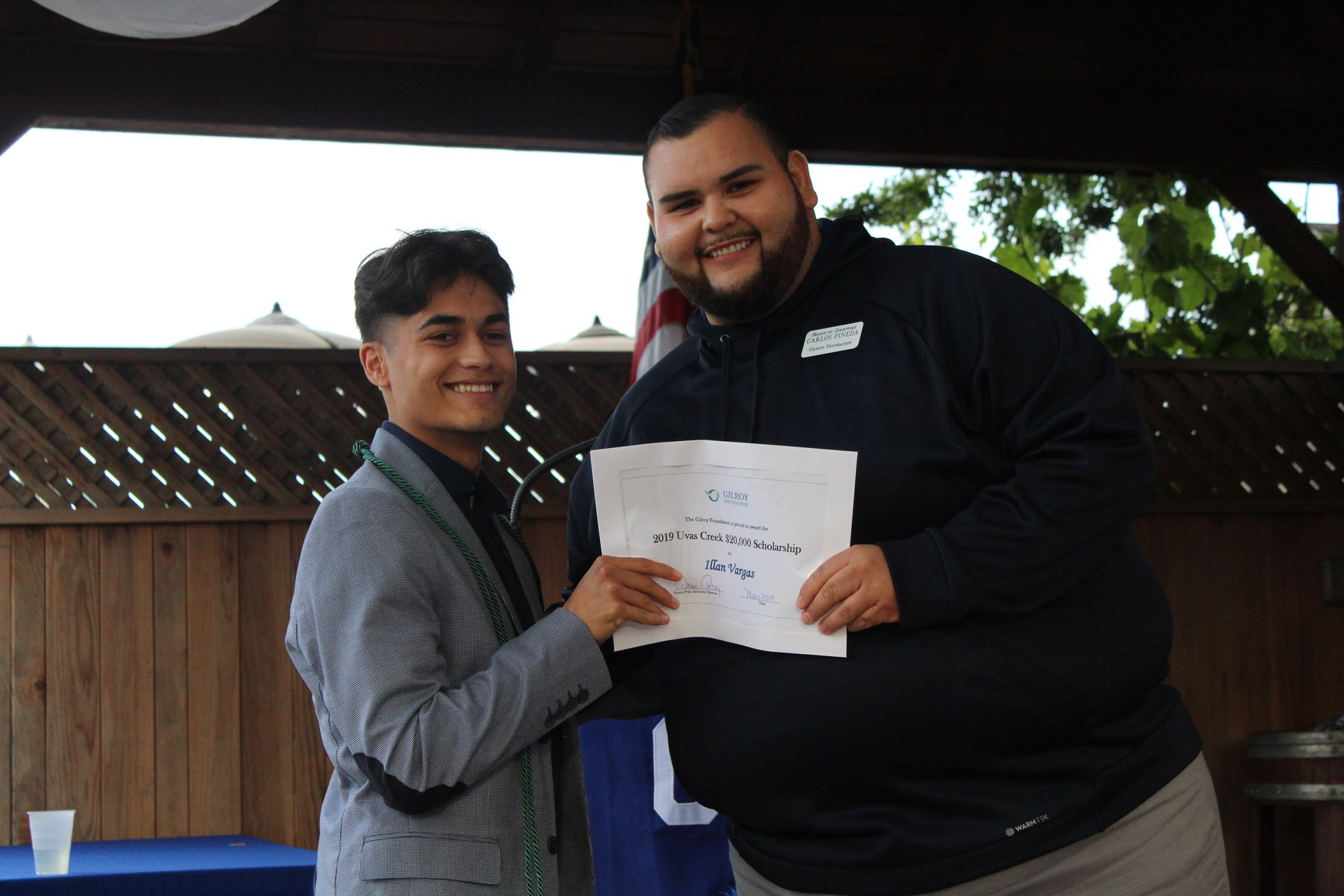 Photo of Carlos Pineda with a boy scholarship recipient