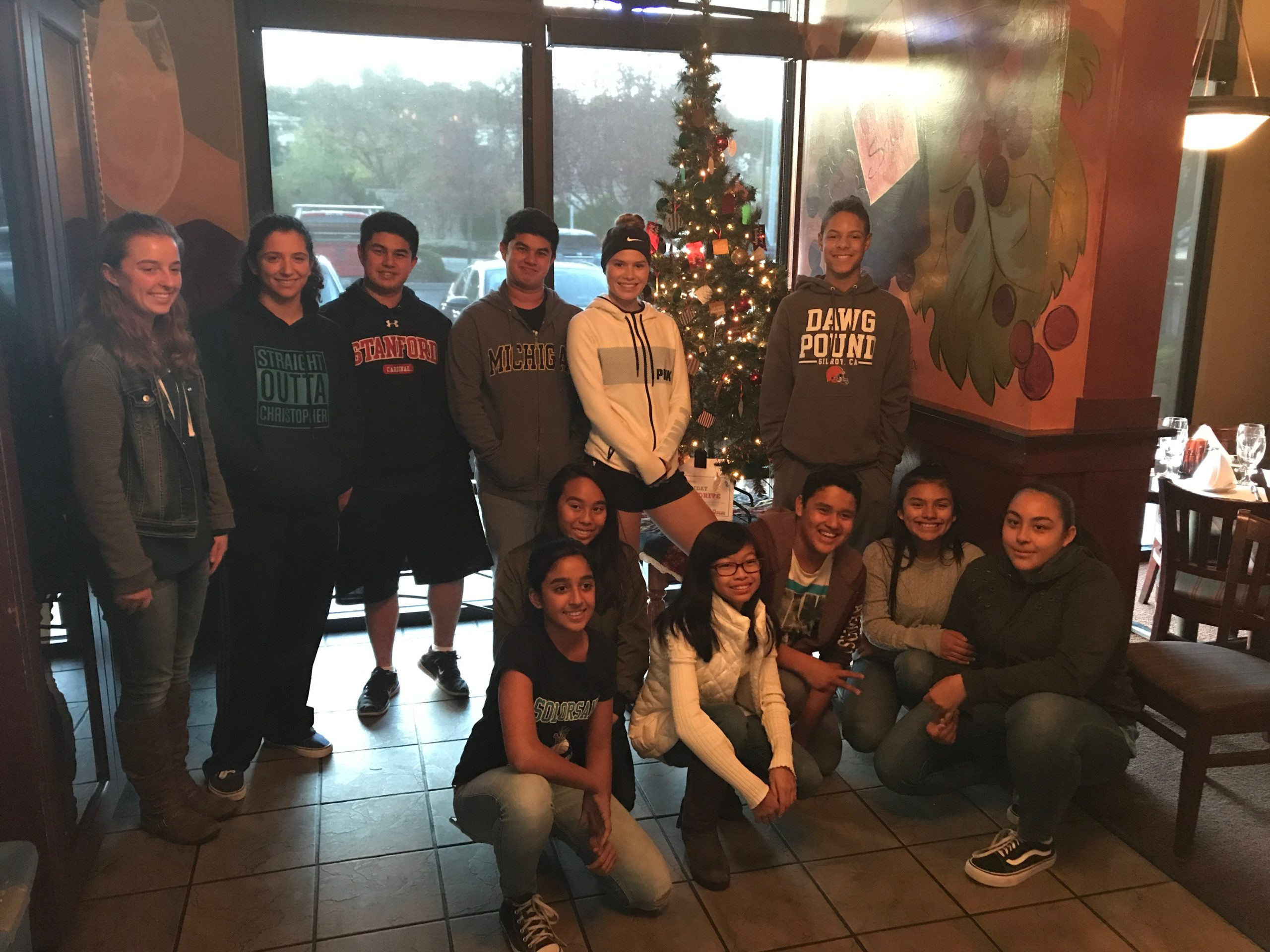 Photo of Youth Board Kids and their decorated Giving Tree at West Side Grill