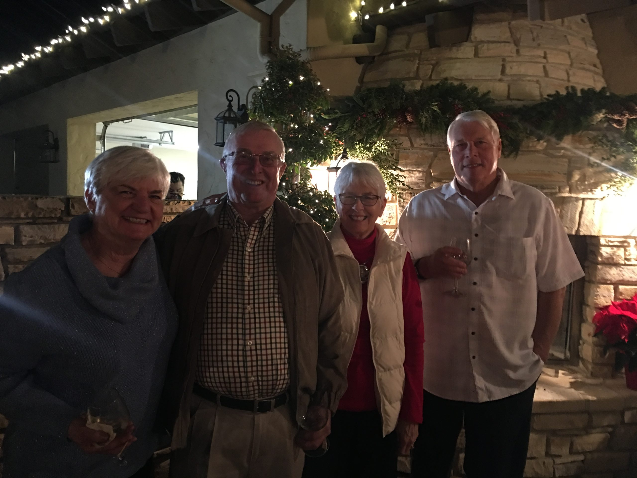 Photo of 2 couples outside at Gilroy Foundation's Holiday Party in 2018