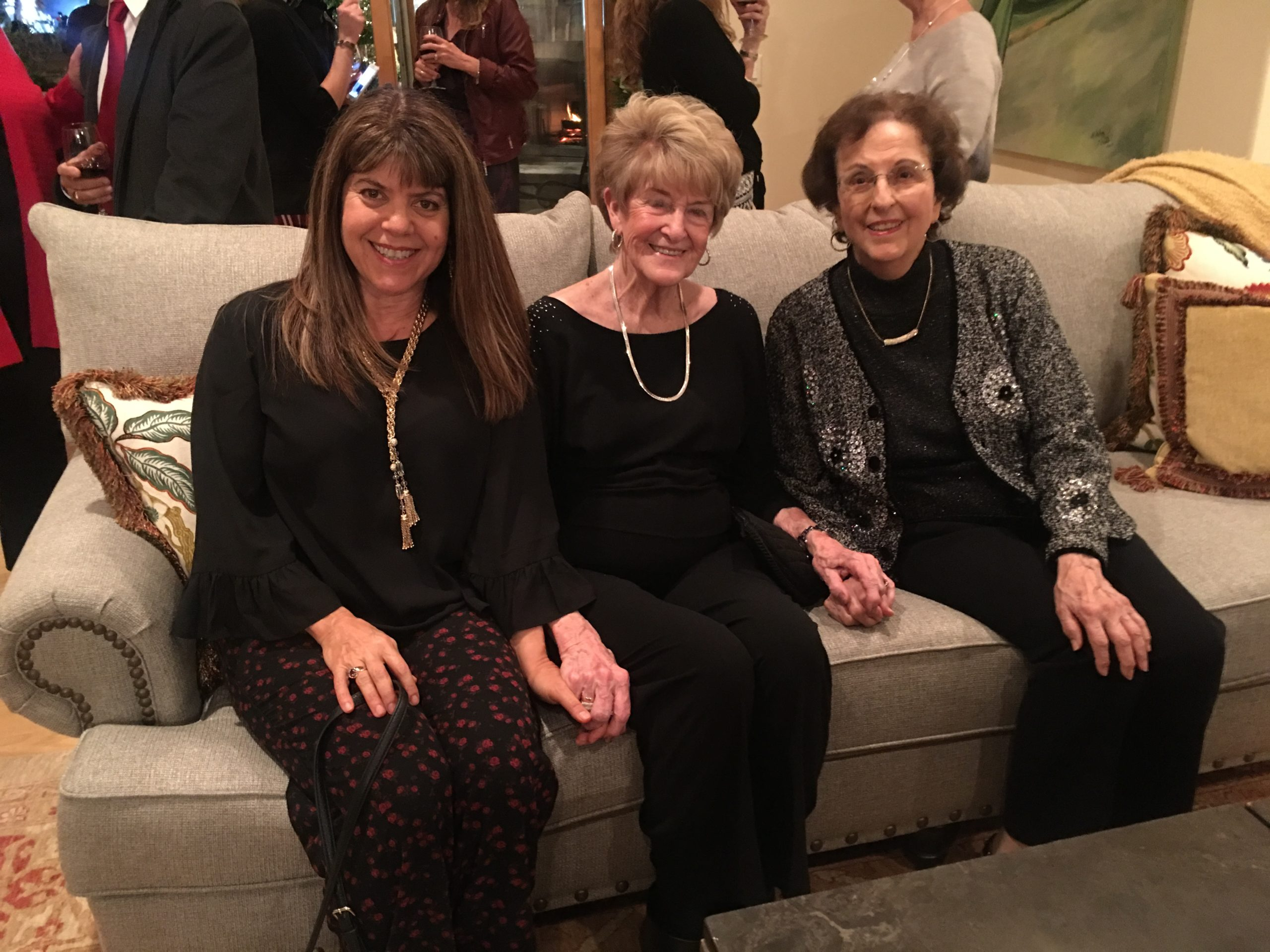 Photo of Marie Blankley sitting on the couch with 2 ladies at the Gilroy Foundation Holiday Party 2018