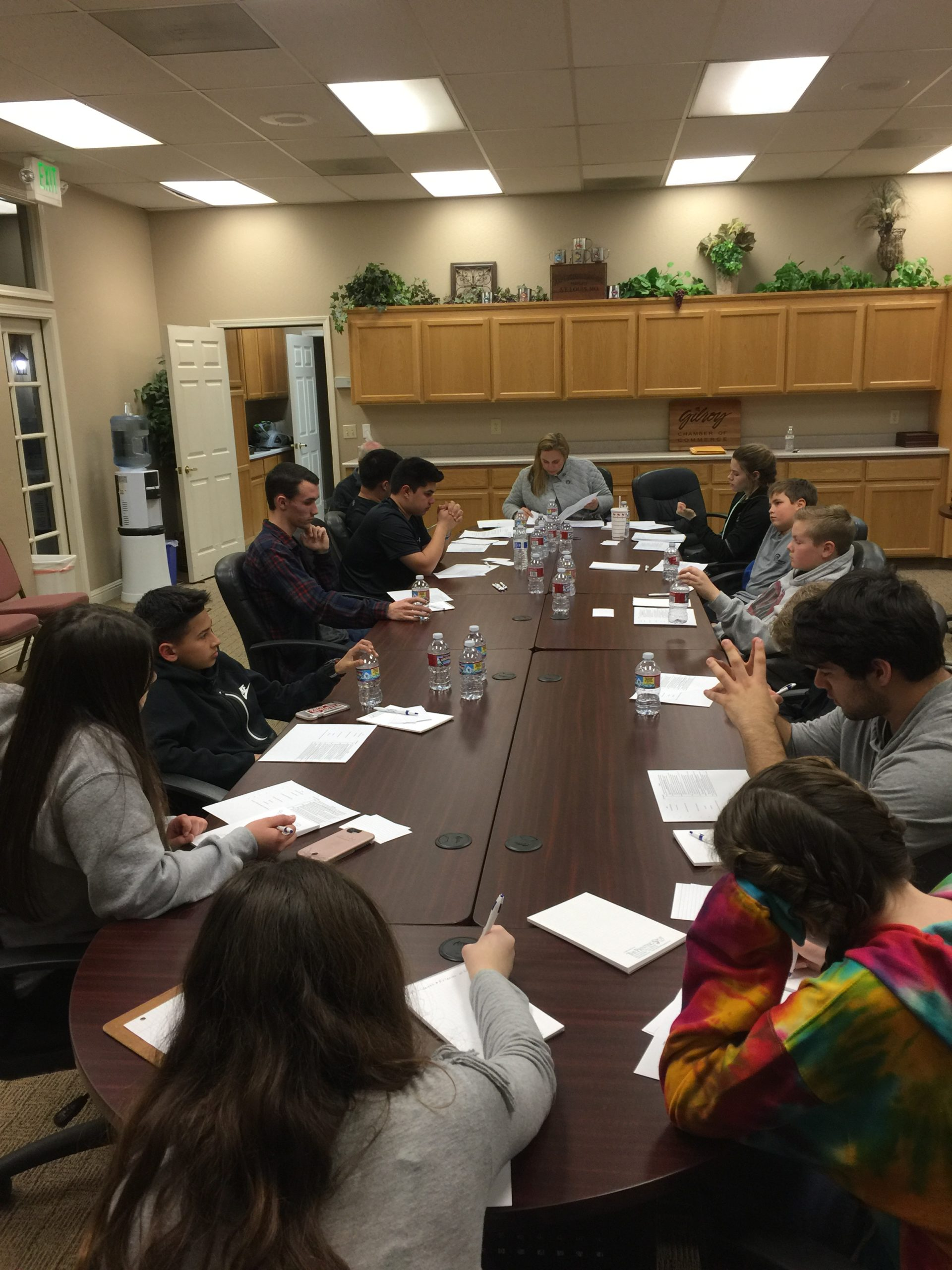 Photo of Gilroy Foundation's 2017 Youth Board at Work at a conference room table