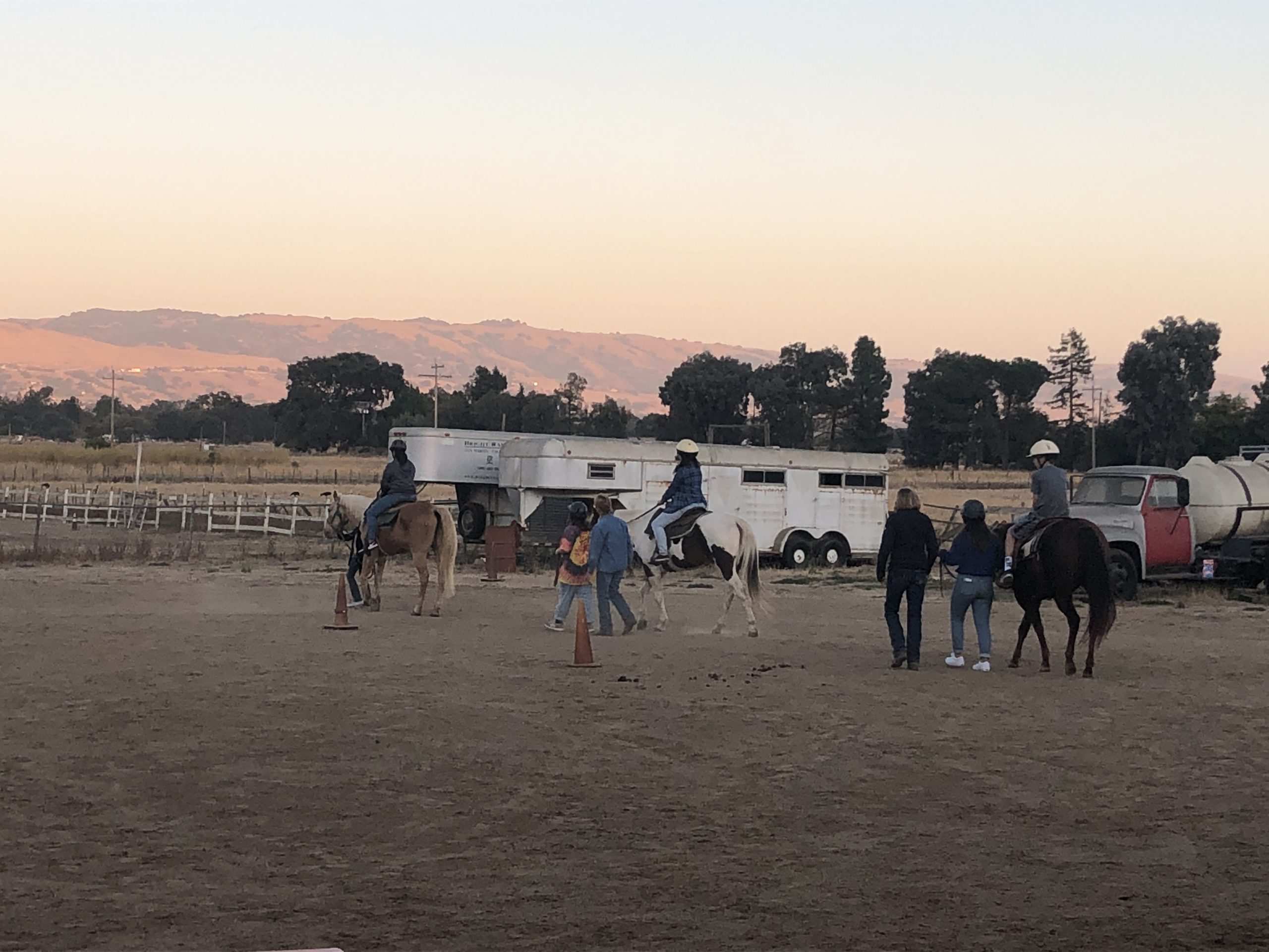 Photo of Youth Board Members being guided around the arena on a horses
