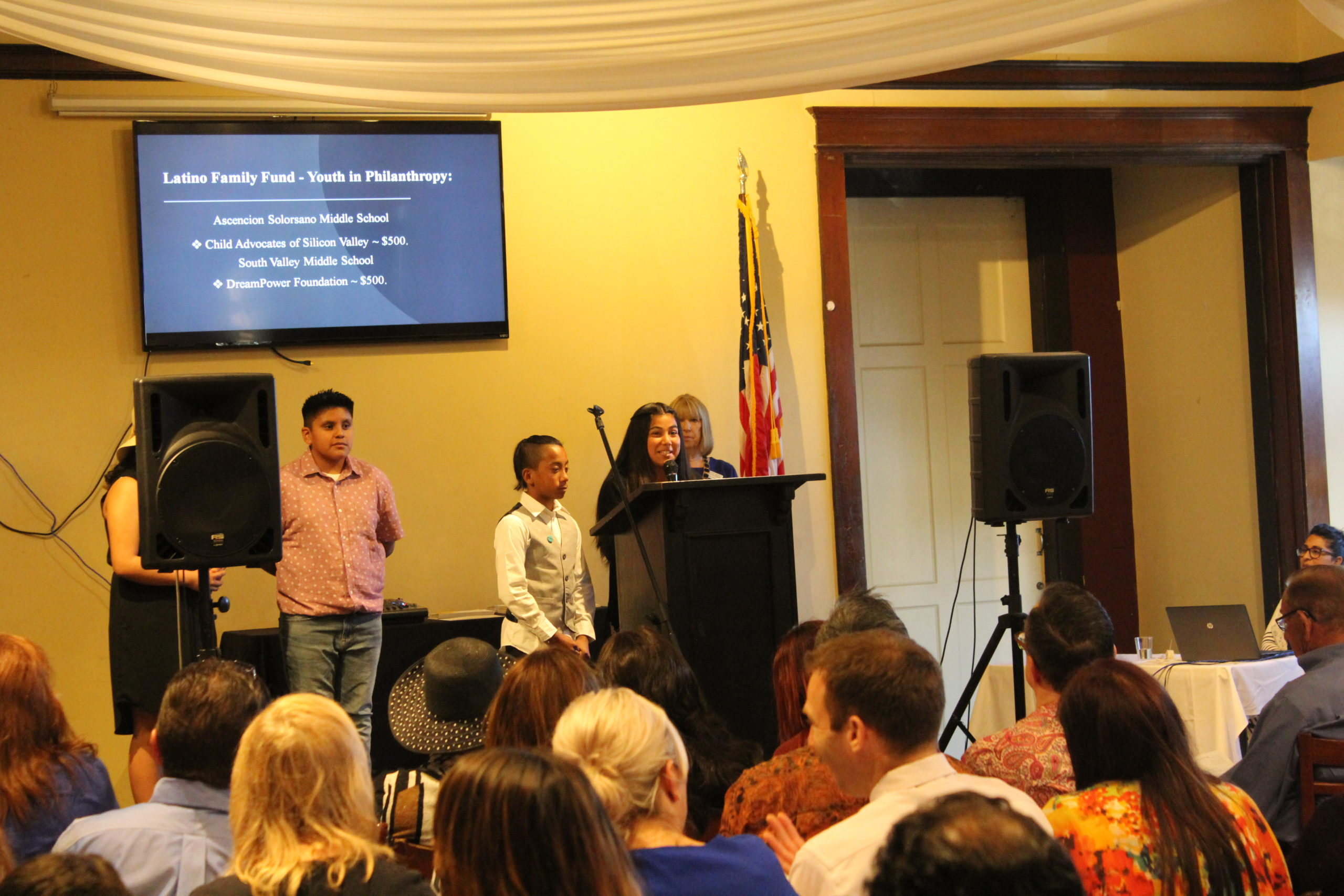 Photo of the Latino Family Fund, Youth In Philanthropy Students speaking on a microphone