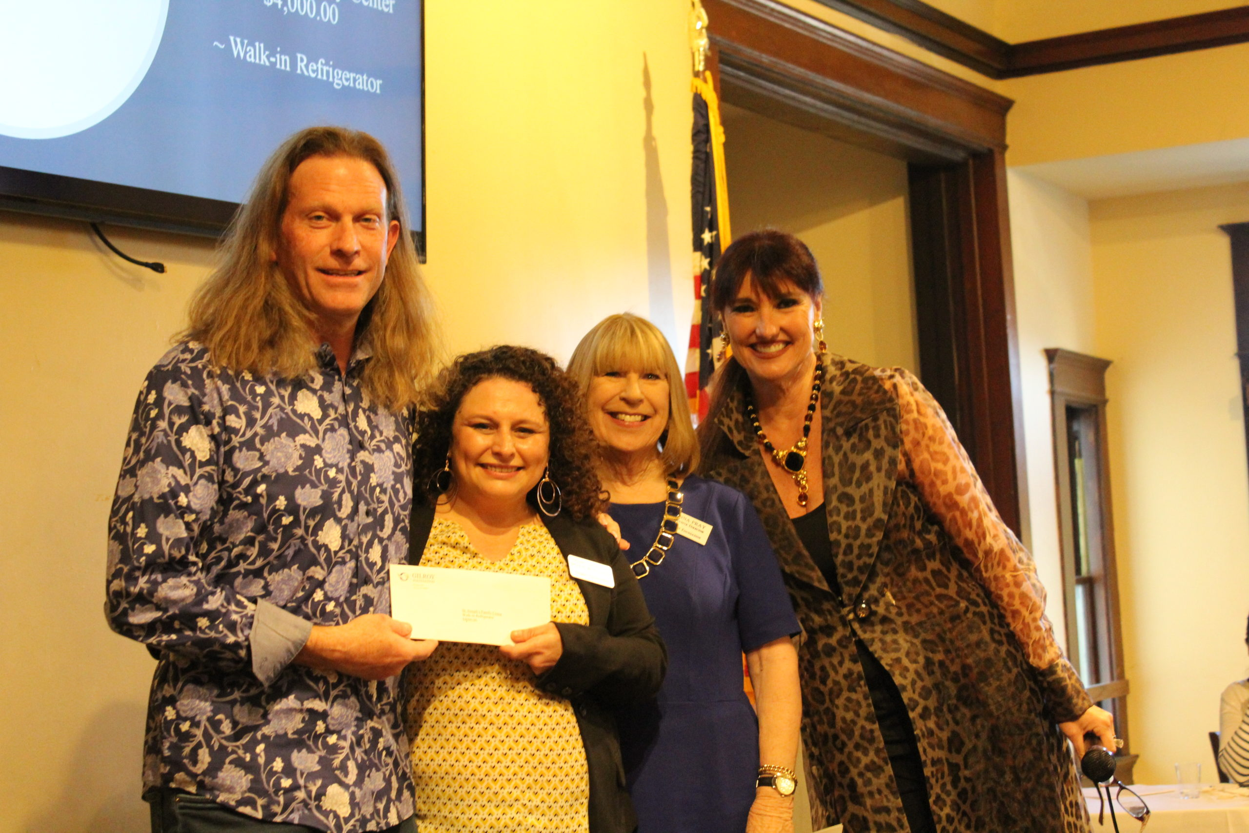 Photo of David Cox receiving a grant check by Roya Wallace. Pictured with Donna Pray and Karen La Corte