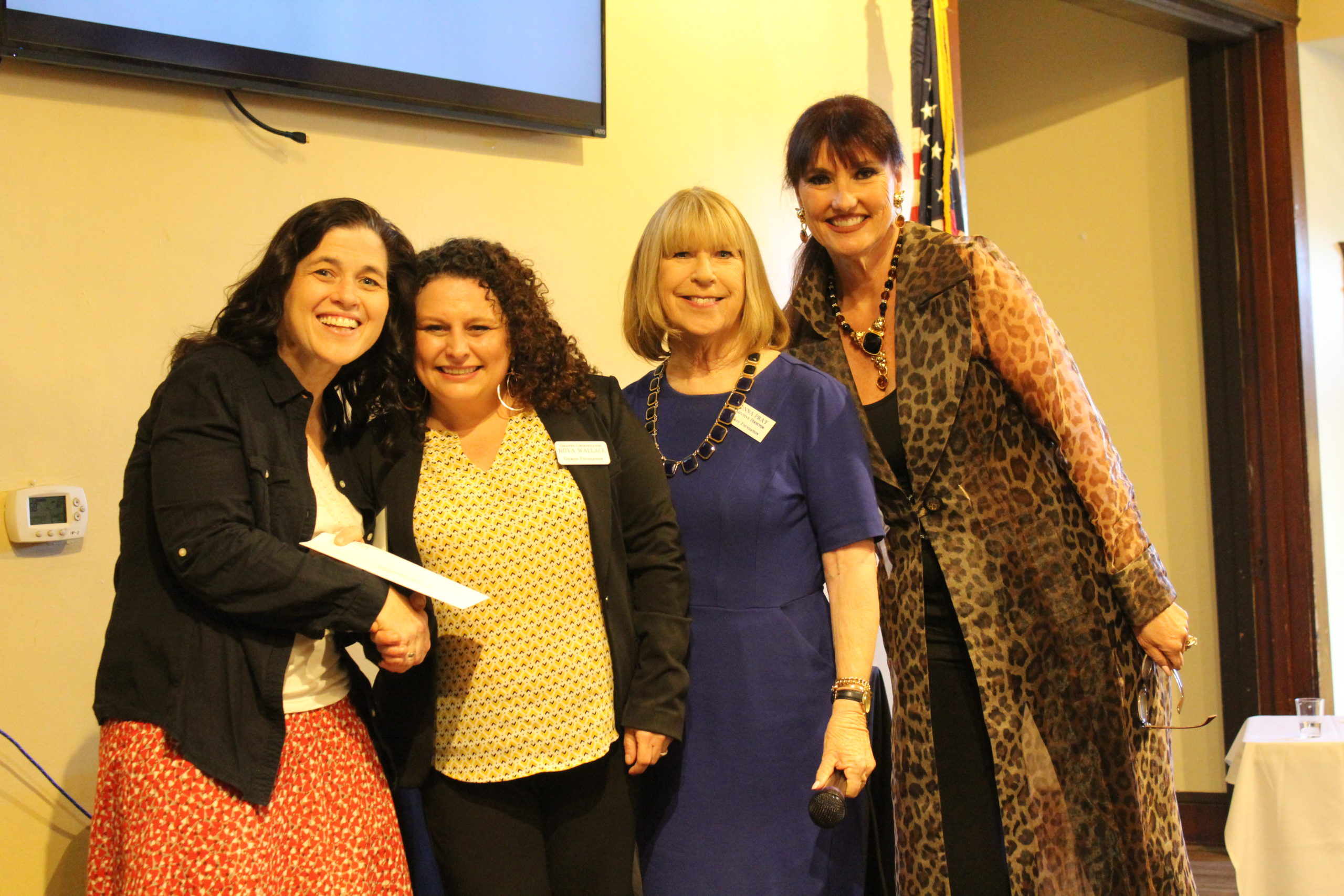 Photo of Skye Taylor receiving a grant from Roya Wallace. Also pictured is Donna Pray and Karen La Corte