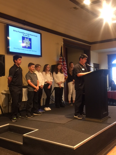 Photo of Gilroy Foundation Youth Board handing out an award at the Annual Meeting and Charitable Giving Presentation in 2017