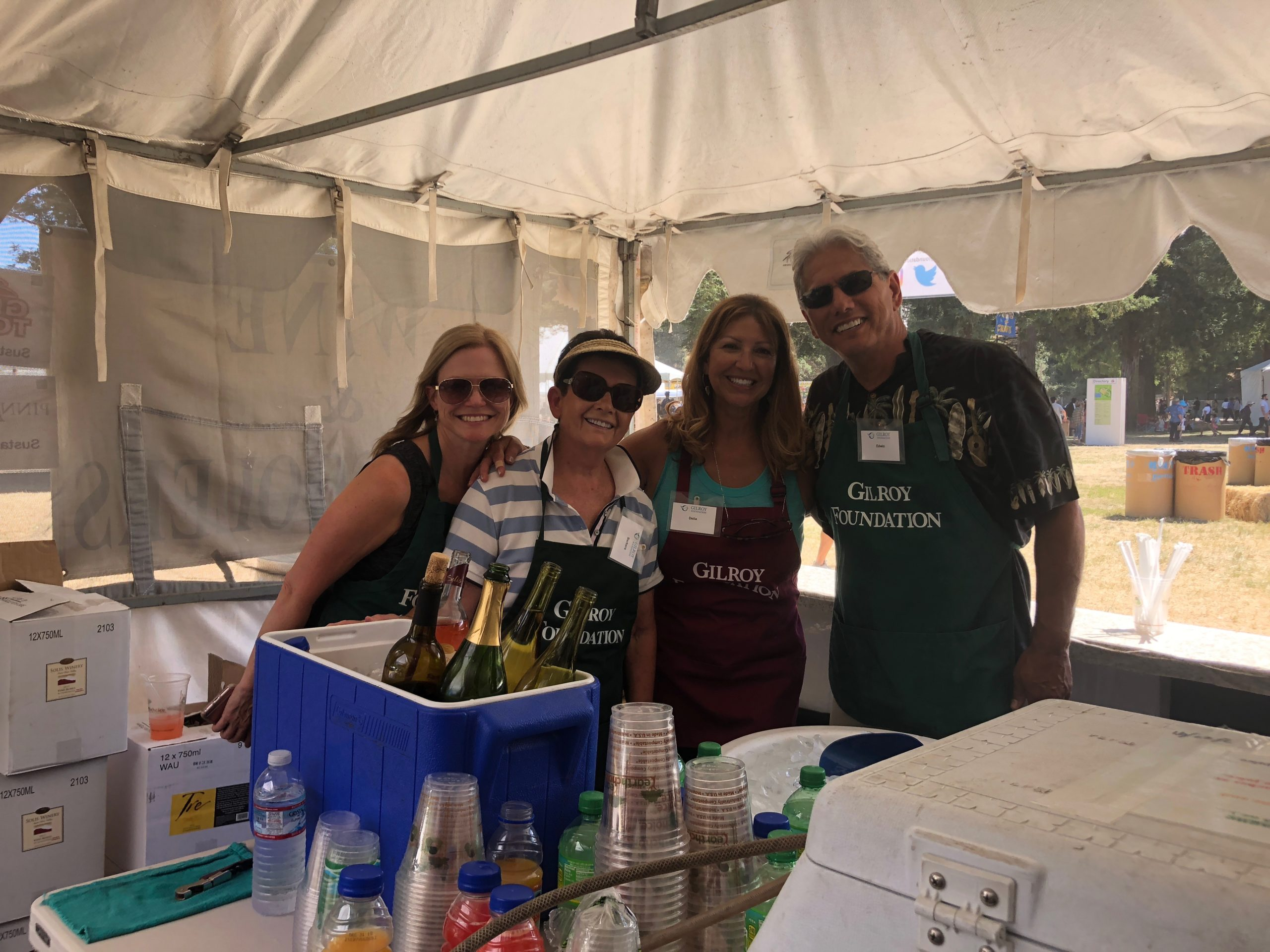 Photo of Lori Kent, Barbara Biafore, Delia Diaz, and Edwin Diaz at Gilroy Foundation Garlic Festival Booth in 2018