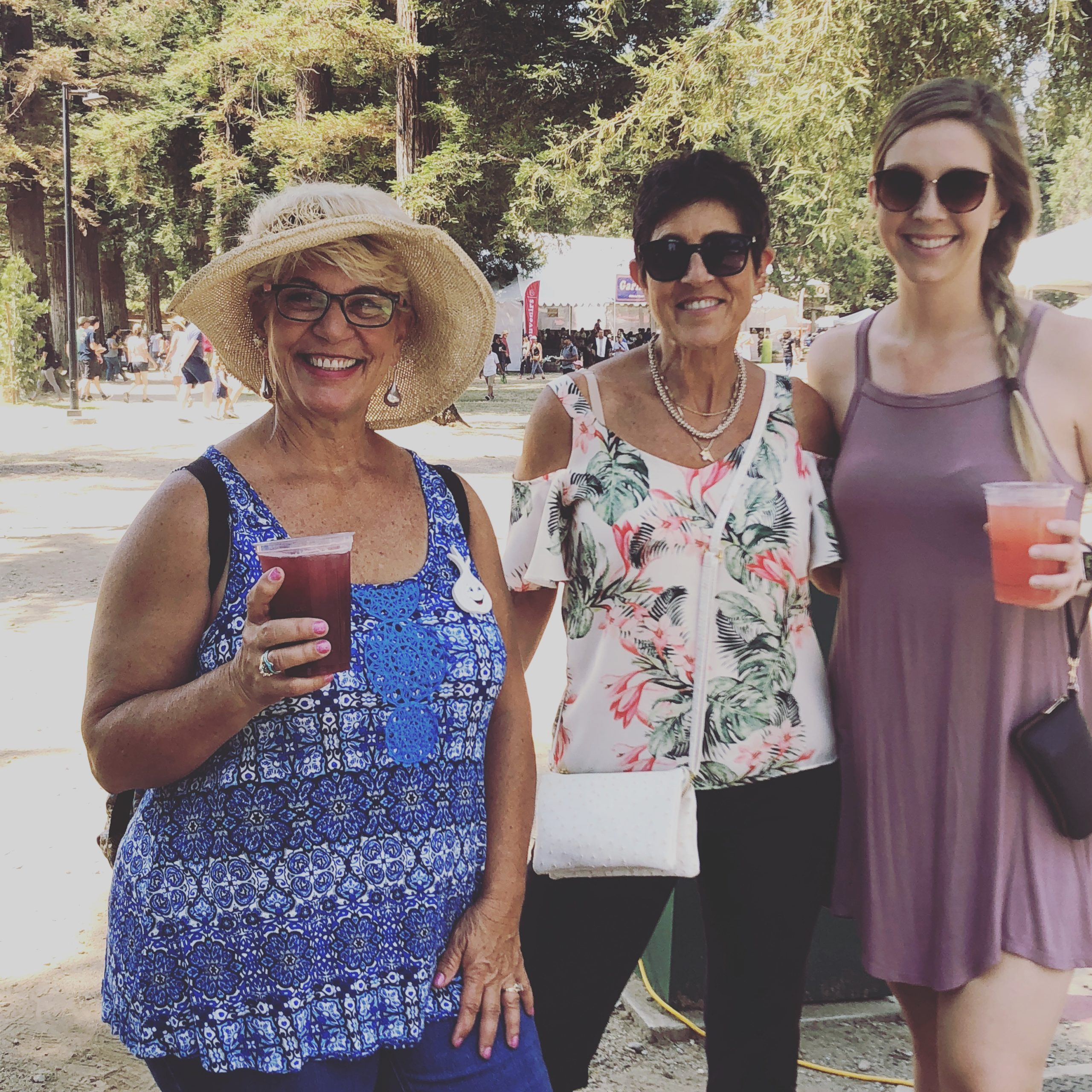 Photo of Ladies at the Gilroy Garlic Festival in 2018 holding Gilroy Foundation Wine Coolers and Sangria.