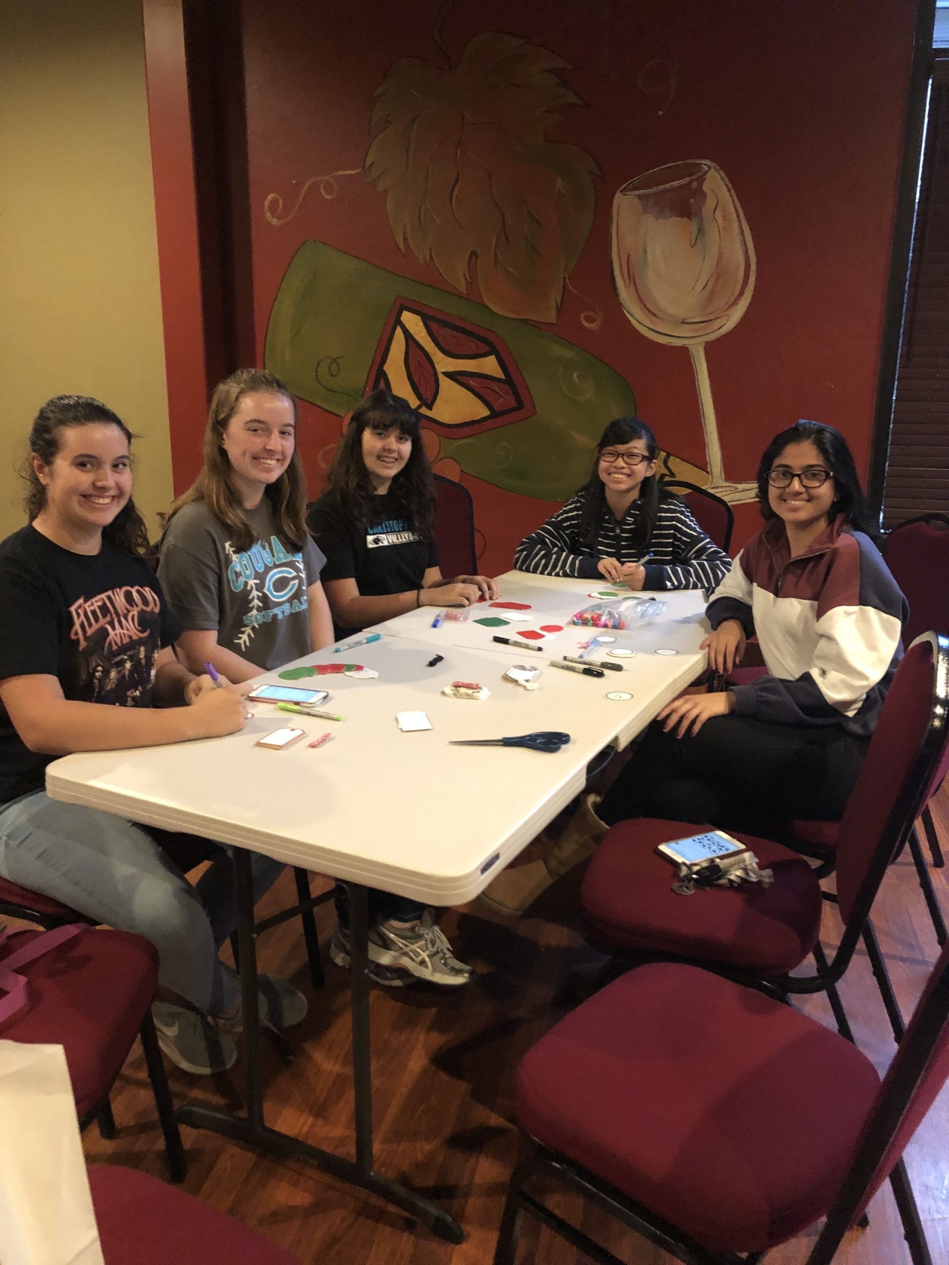 Photo of Gilroy Foundation Youth Board Kids making tags for the 2018 Giving Tree