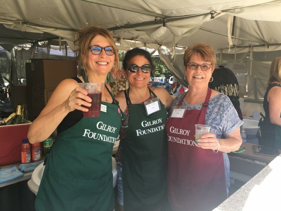 Photo of Judy Lazarus, Jeanie Rizzuto and Joann Kessler serving at Gilroy Foundation's Garlic Festival Wine Booth in 2018