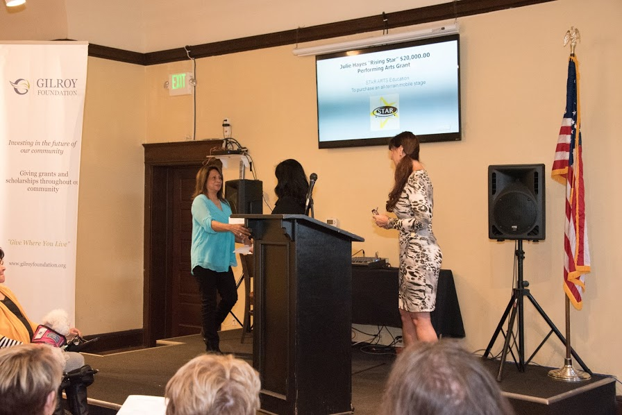 Photo of Karen La Corte and Lissa Gaffney awarding a grant at the 2018 Annual Meeting and Charitable Giving Presentation