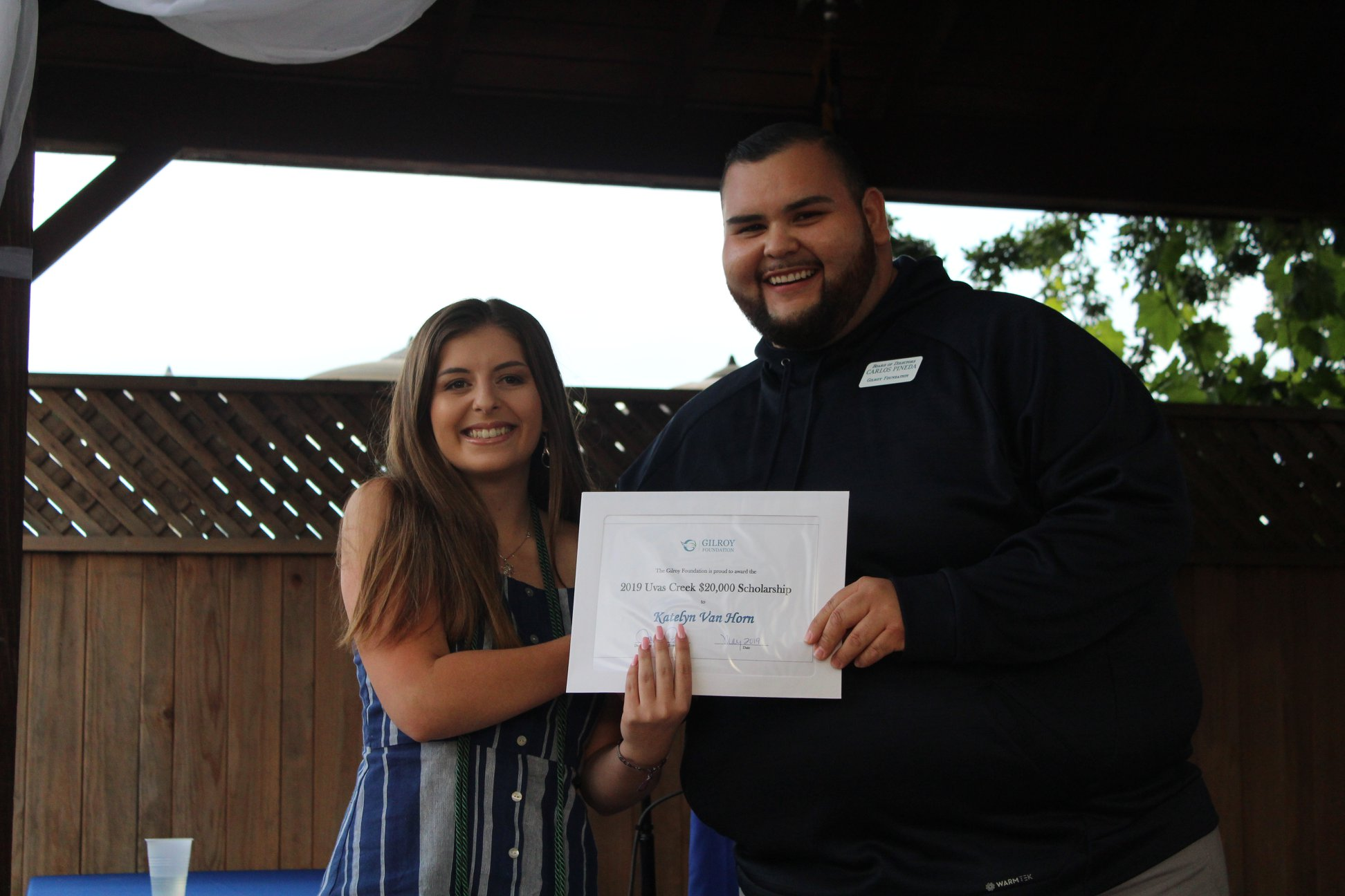 Photo of Carlos Pineda with a girl scholarship recipient