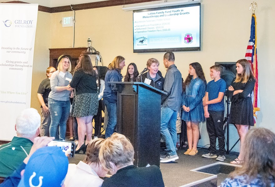 Photo of Youth Board on stage handing out their grant award at the 2018 Annual Meeting and Charitable Giving Presentation