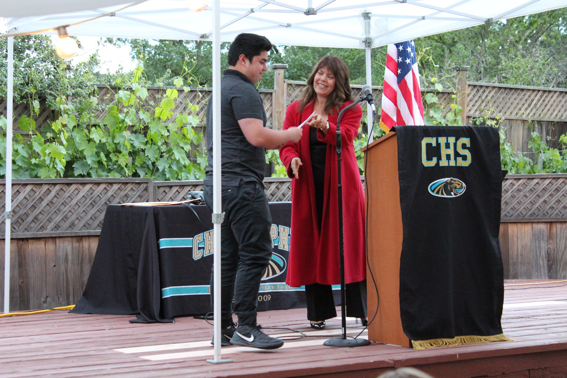 Photo of Marie Blankley giving out a scholarship award
