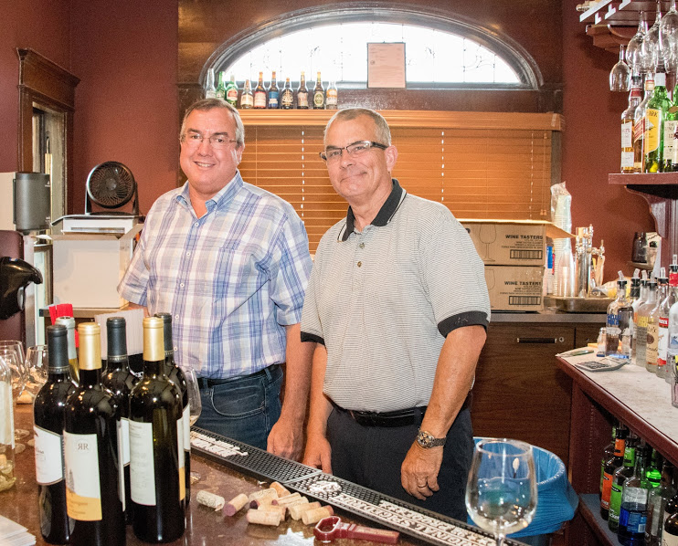 Photo of Randy Costa and Jim Rhodes tending bar at the 2018 Annual Meeting and Charitable Giving Presentation