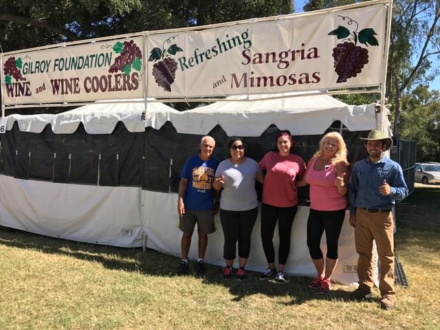 Photo of Gilroy Foundation's Garlic Festival Wine Booth patrons and volunteers
