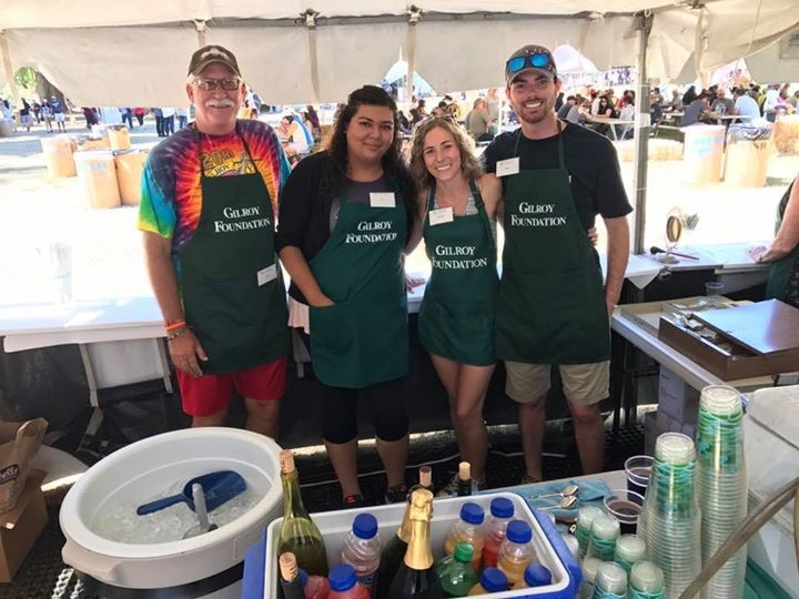 Photo of Joel Goldsmith, Yesenia Gonzalez, Amelia Taylor and Matt Titus volunteering at Gilroy Foundation's Garlic Festival Wine Booth