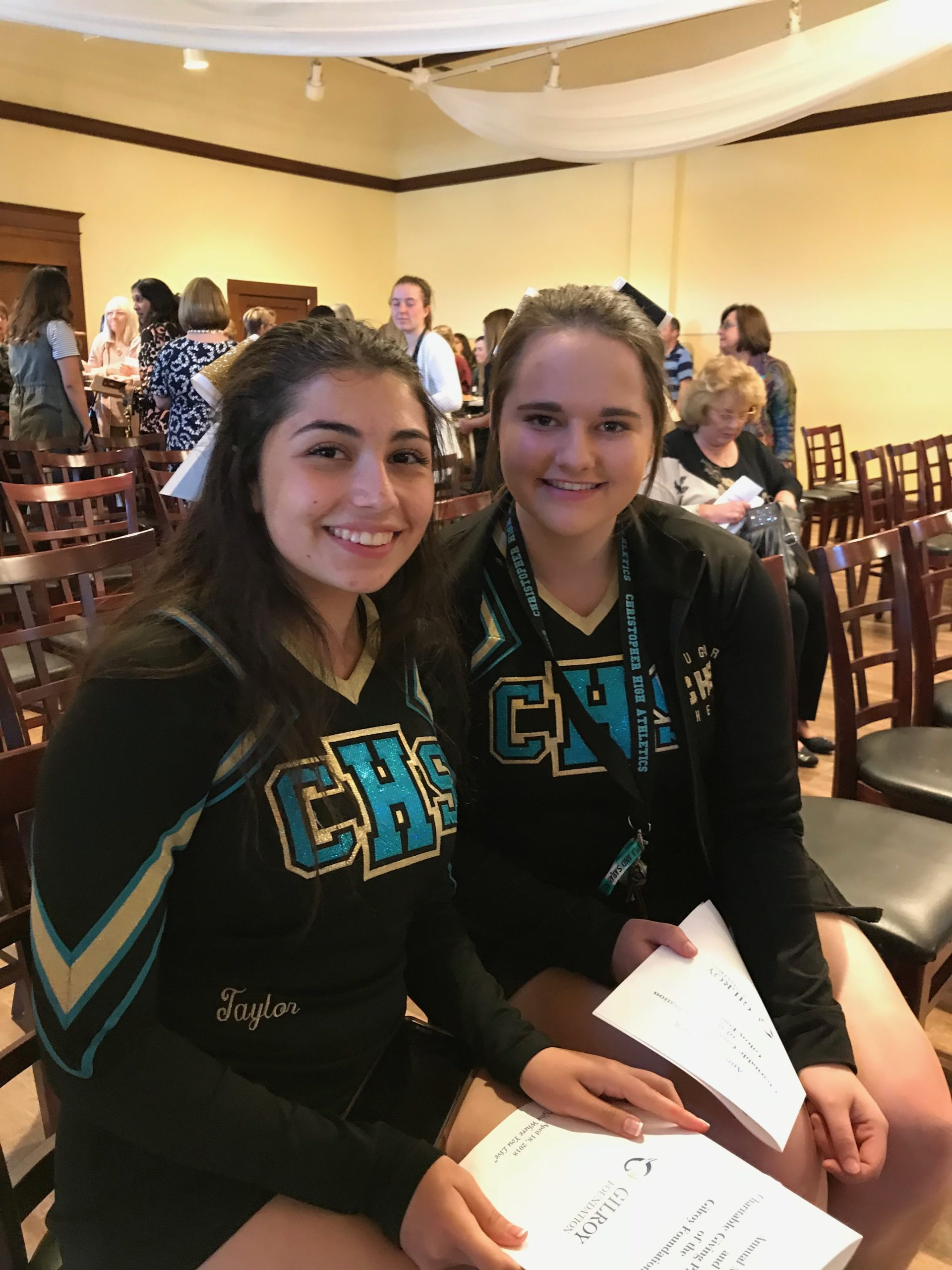 Photo of two Christopher High School Cheerleaders at the 2018 Annual Meeting and Charitable Giving Presentation